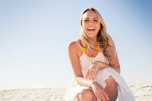 Portrait of smiling mid adult woman on beach