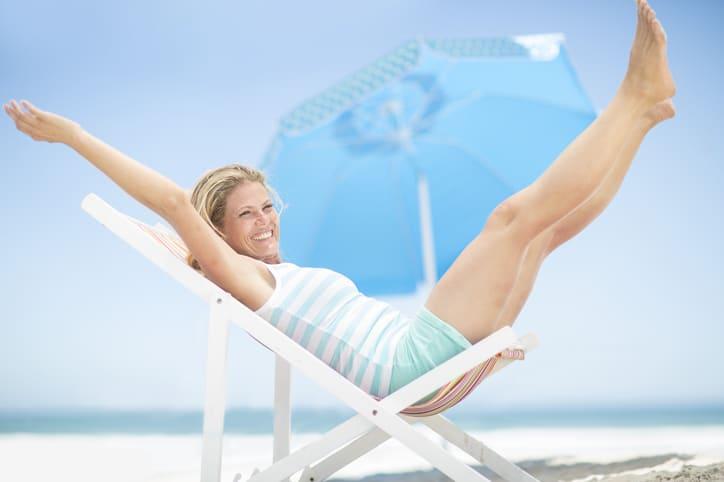 Exuberant woman on a beach chair